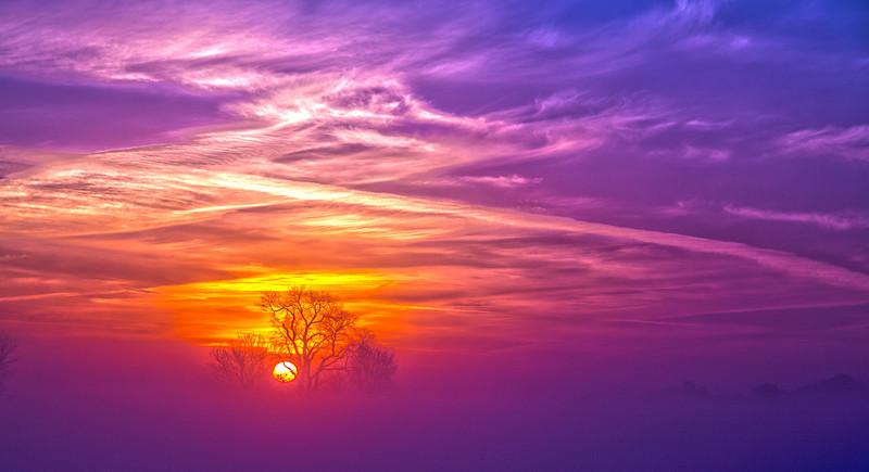 Skies at sunrise on Mokelumne River in the Sacramento Delta