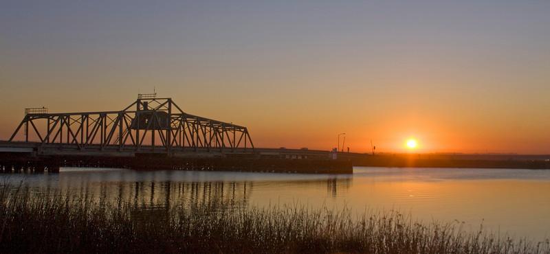 Bridge over the Mokelumne River near Isleton, California at Sunrise in October, 2008.