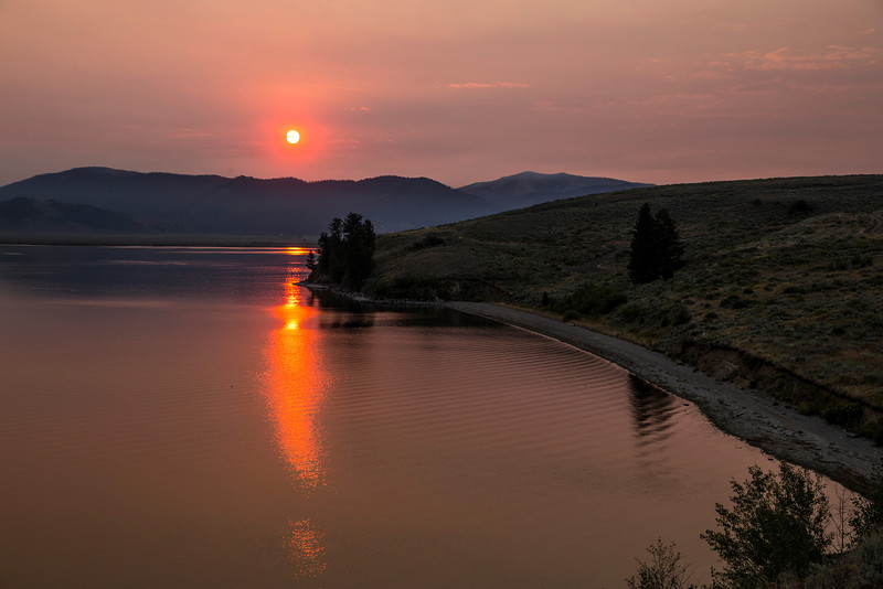 Sun reflected in the water at Henry's Lake, Idaho. August 2013