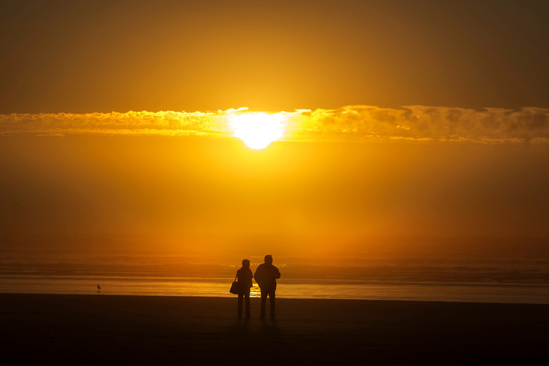 Man, woman and sunset