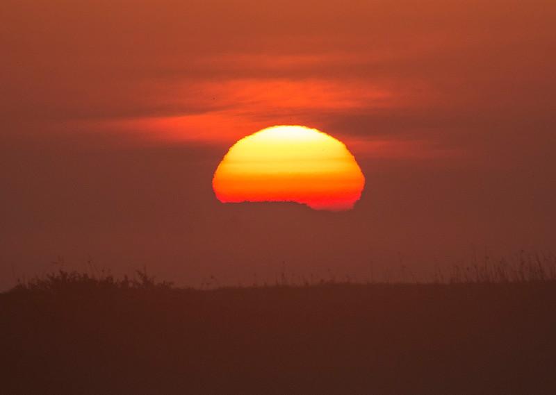 Sun rising over Mokelumne River at Sunrise. Isleton