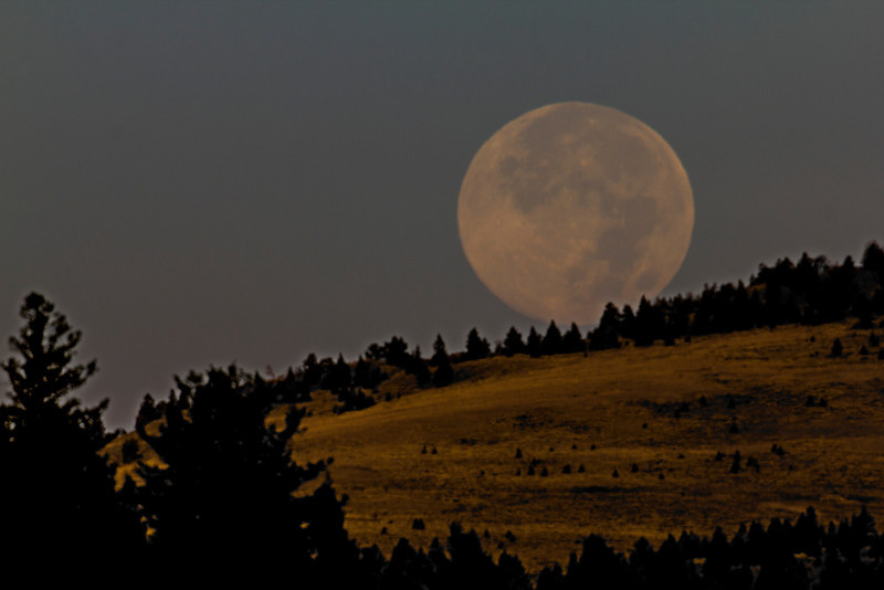 Full moon setting over Henrys Lake Mountains in Idaho. Sep 29, 2012.