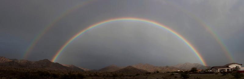 Double rainbow over the North Gila mountains north of Yuma, Arizona during a rainstorm on Feb 27, 2010.