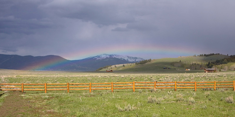 Rainbow over Sawtelle Meadows, from RedRock RV Park, looking East towards Yellowstone. Normally, the rainbows here are higher with more pronounced curvature than this one.  June 13, 2008. Island Park, Idaho.