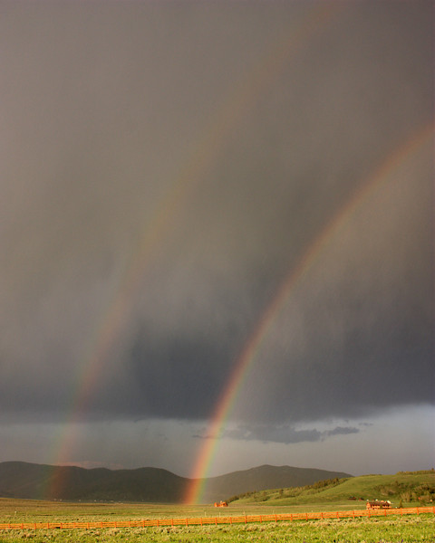 A quick moving and thundering storm came through RedRock RV Park (June 25, 2008) in the early evening and created these two rainbows. Island Park, ID