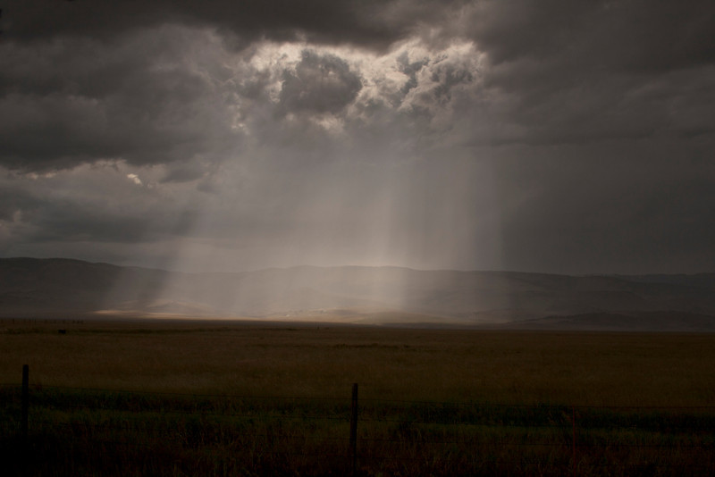 Crepuscular Rays during storm on the Madison River plain along highway 287 near Ennis, Montana on July 21, 2010.