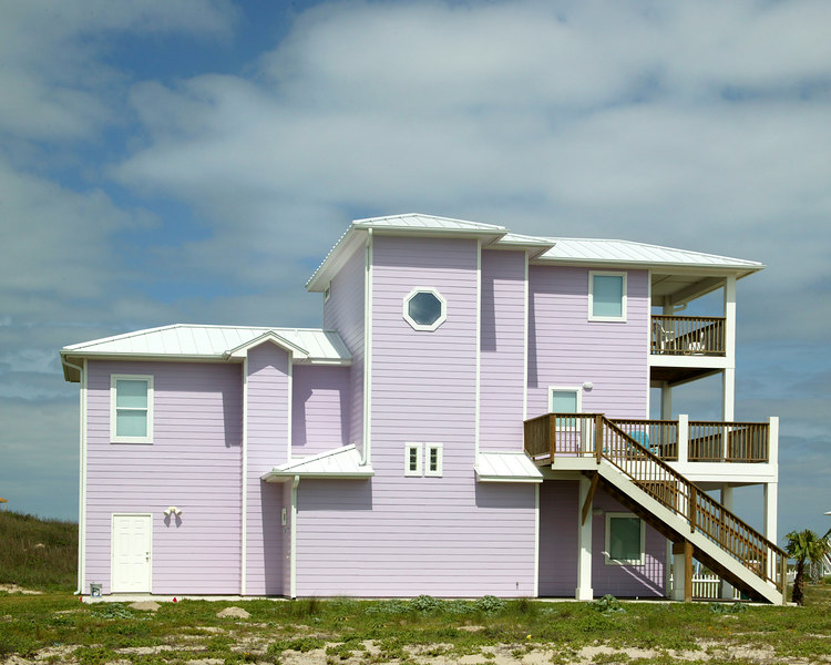 House on Mustang Island, southern Texas Gulf Coast. An entire development was painted in different pastel colors like this.