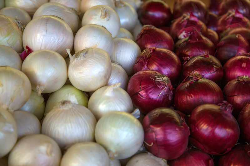 Onions (white and red) on display at Casa de Fruta. California