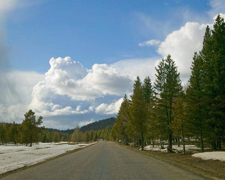 Cumulus clouds at the end of Red Rock Road in Island Park, Idaho looking West in May, 2009;.