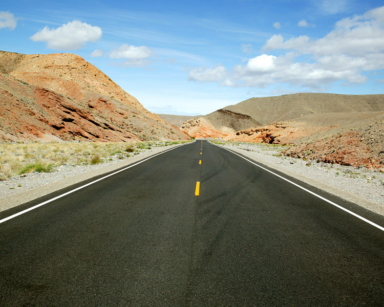 Death Valley Road and colorful cliffs