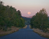 Red Rock road and early morning full-moon setting in Idaho. Sep 15, 2008.