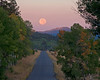 Red Rock Road in Sawtelle Meadows, near Island Park, Idaho at (full) Moonset on Sep 15, 2008, looking West.