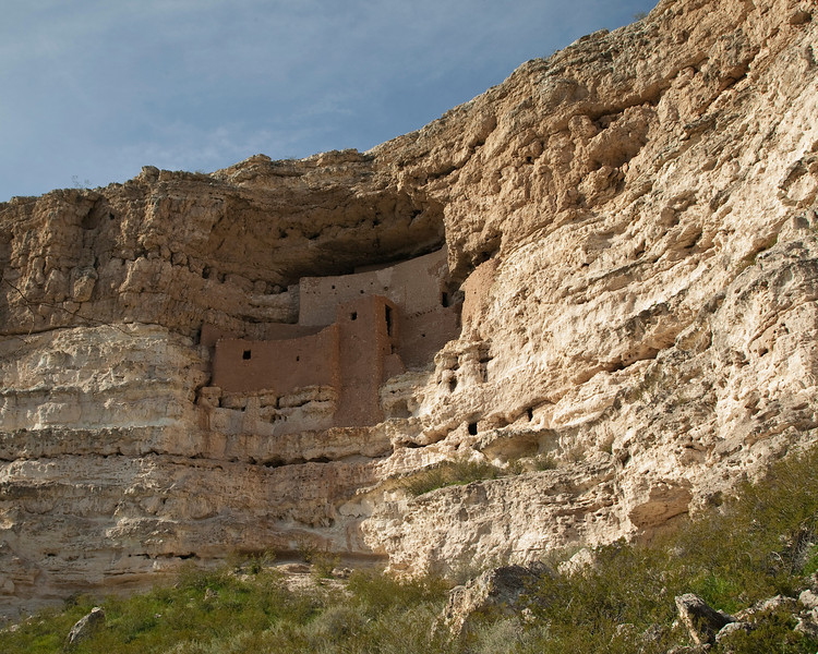 """Montezuma's Castle National Monument, near  Camp Verde, AZ. Built into this sandstone cliff, these ruins are the remainder of a large """"home"""" established almost 1,000 years ago and deserted by it's native inhabitants about 600 years ago, it is remarkable because it still stands against all odds of weather and human disturbance. The sandstone is very fragile. March 2010"""