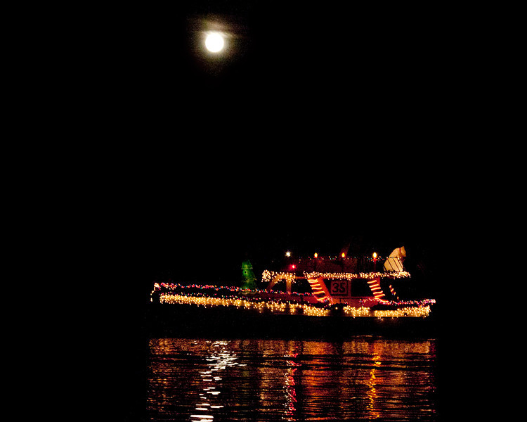 Parade of Lights and Full Moon over the Lower Mokelumne River. Taken from the pier of Delta Shores RV and Marina on Brannan Island in the Sacramento Delta, Dec 10, 2011.