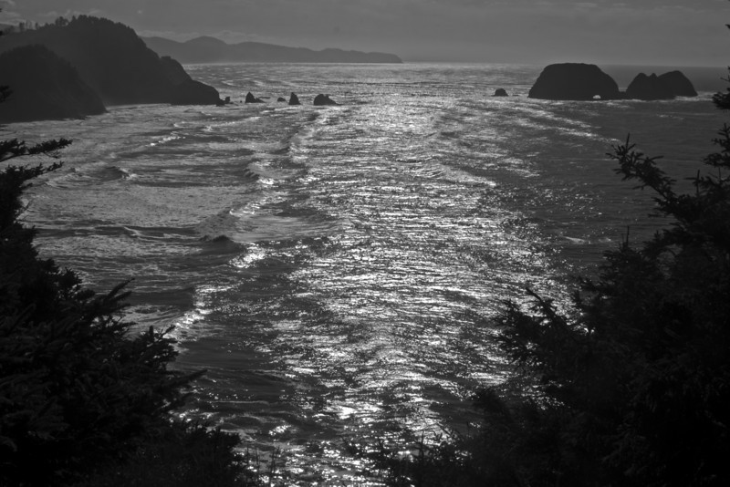 View south of Cape Meares State Park in Oregon USA with 3 arches rocks. (grayscale photo). Nov 1, 2009