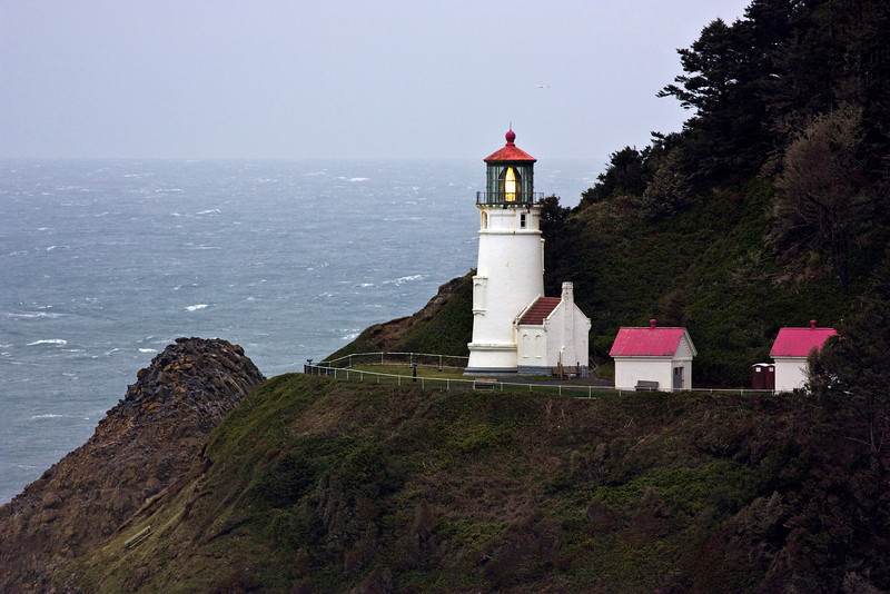 Heceta Head lighthouse is located in a cove at the mouth of Cape Creek and is 13 miles of Florence, Oregon. It was first lit in 1894. Now, the automated beacon, seen 21 miles from land, is rated as the strongest light on the Oregon coast.