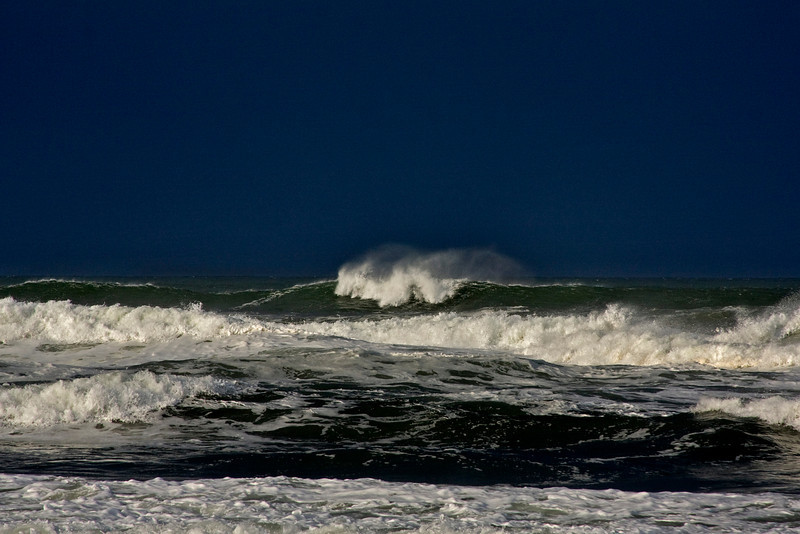 Wind swept ocean waves on the Oregon Coast with dark sky behind (storm approaching). November 2009