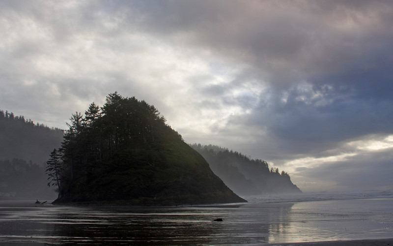 """A sea stack called Proposal Rock in the ocean at Neskowin State Beach, Oregon. Oct 31, 2009  Neskowin is an indian name that means """"plenty fish""""."""
