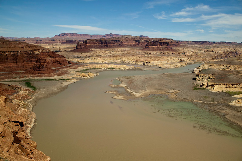 Looking over the far end of Lake Powell (just as the Colorado River flows into it. This photo was taken from the Hite overlook in the Glen Canyon National Recreation Area. The lake has a green tinge to it which contrast beautifully with the red sandstone buttes that surround it. Canyonlands is probably only 40 miles north of here. April 10, 2010.
