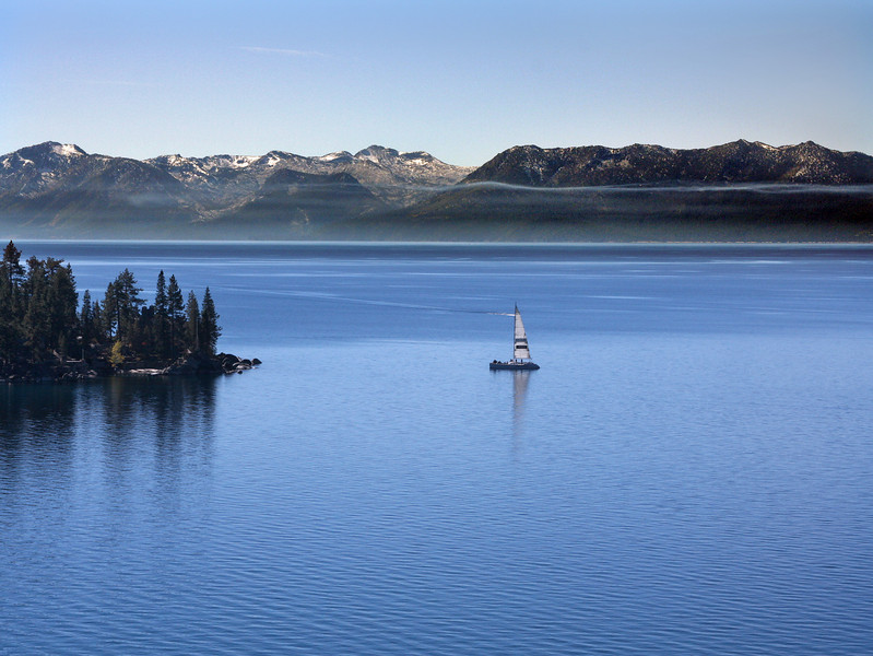 Northeastern end of Lake Tahoe in the Sierra Nevada mountains and Sailboat. October 2007