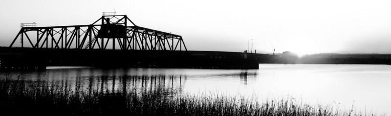 Bridge and Sunrise over the lower Mokelumne River near Isleton, CA in the Sacramento Delta, in Black and White. Oct 2008