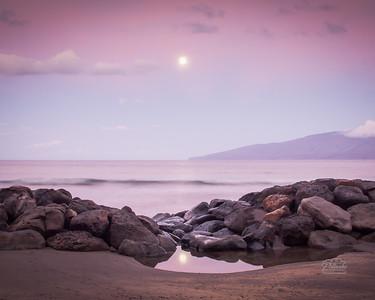 Moon setting over Lana'i at Launiupoko, Maui