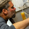 Brewing beer is part science and part art.  Here Dave measures the specific gravity of the mash...