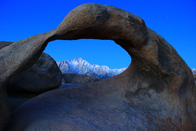 Early morning light on the Sierra Nevadas as viewed through the Mobius Arch
