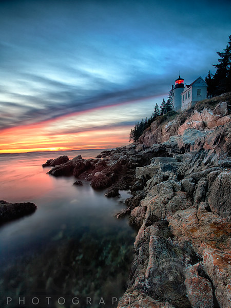 Vertical View of a Lighthouse on a Cliff at Sunset, Bass Harbor Head Lighthouse, Maine