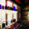 Colorful Medicine Bottles in the Window in an Old Colonial Time Pharmacy