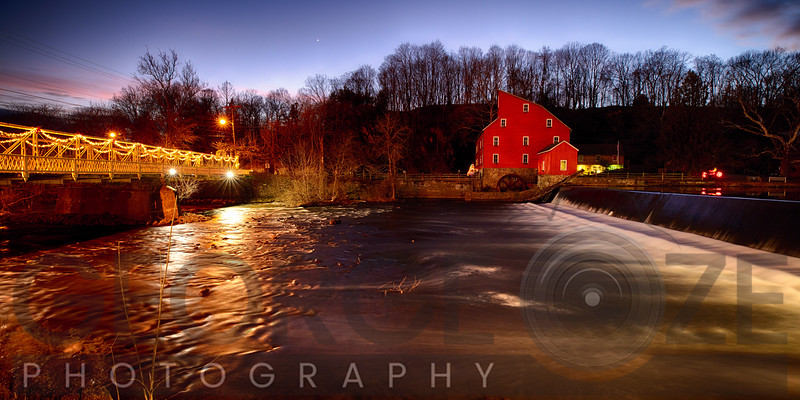 The Historic Red Mill and Clinton Bridge at Night