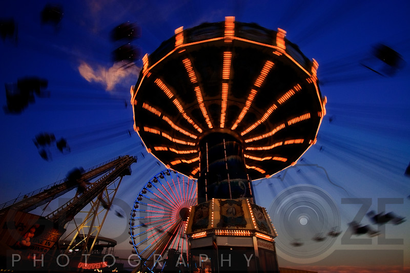 Low angle View of a Spinning Chain Swing at Sunset, Wildwood, New Jersey
