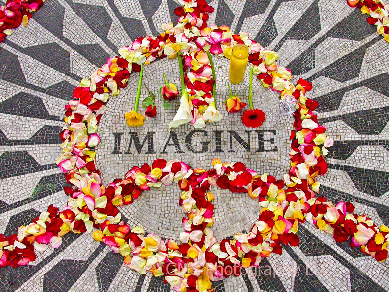 """The """"Imagine"""" mosaic at edge of Strawberry Fields and across from Dakota in Central Park, New York City"""