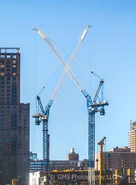 Crossed Cranes In New York City