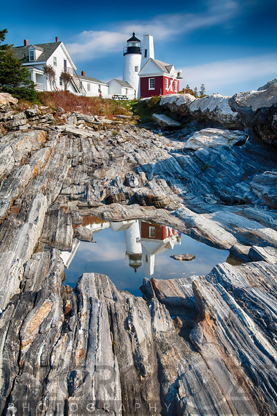 Low Angle View of the Pemaquid Point Lighthouse with Image Refelected in Tidal Pool, Maine