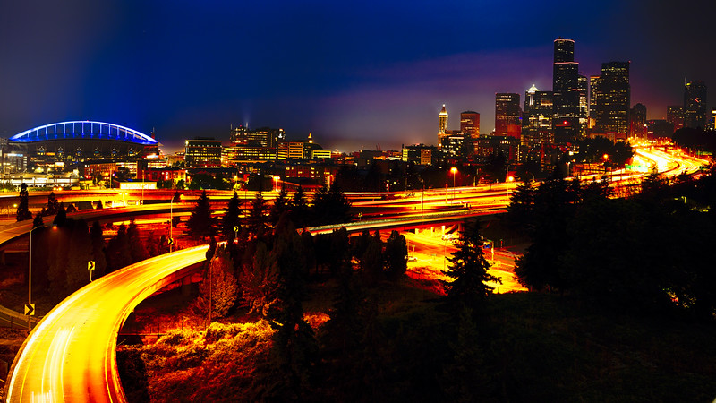 Downtown Seattle At Night with Freeways Passing Through
