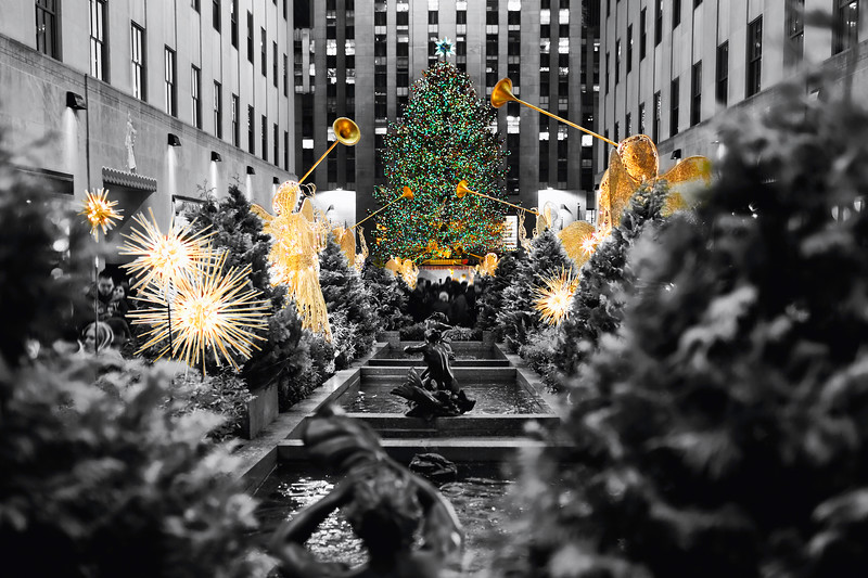 Christmas Tree with Trumpeting Angel Sculptures Illuminated at Night, Rockefeller Center, New York City
