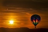 Sunset with hot air balloon in sky