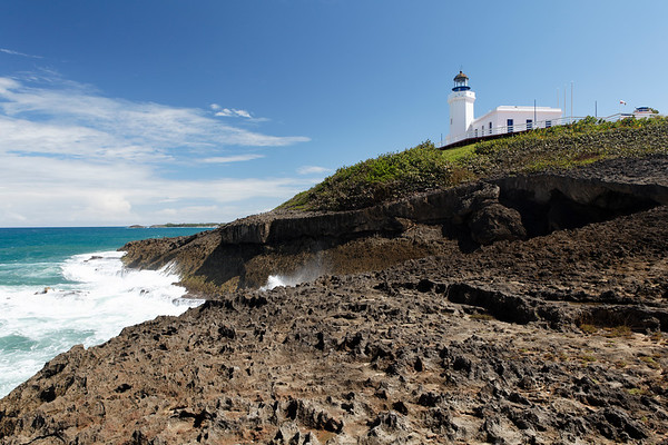 Low Angle View of a Lighthouse on a Cliff, Punta Morillos, Arecibo, Puerto Rico