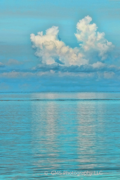 Cloud formation is reflected is water at Whitehouse Jamaica in 2012