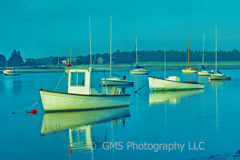 Boats docked in Maine harbor create a peaceful yet organized scene.