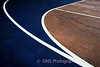 Lines and textures on outdoor basketball court create interesting patterns.