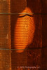 A sunbeam shaped by an opening in the barn wall projects light onto a wooden barrell standing nearby.  Details of the barrel are enhanced with a very subtle texture overlay.