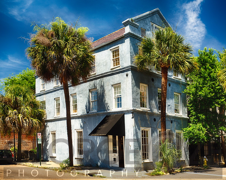 Quaint Charleton Street Corner House with Palmetto Trees