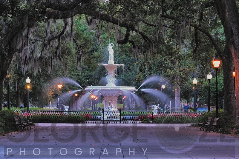 View of the Forsyth Park Fountain Through Spanish Moss Draped Oak Trees at Dusk, Savannah, Georgia