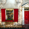 Entrance View of a Historic House in Charleston, with Bright Red Door and Window Shutters, Charleston, South Carolina