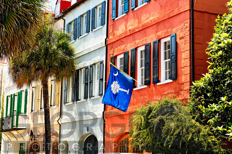 Low Angle View of Colorful House Exteriors with a Flag, Charleston, South Carolina, USA