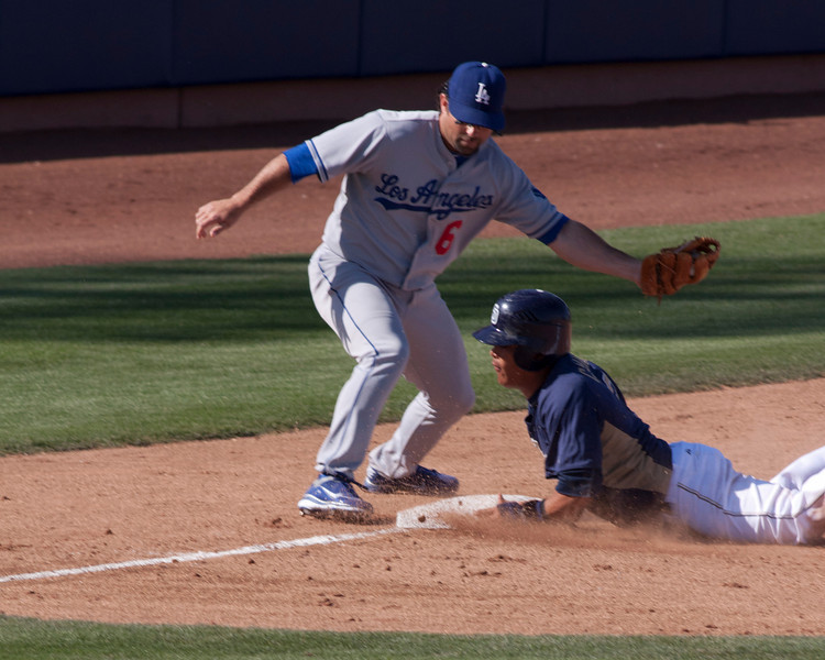 Close call at 3rd base in game between Padres and Dodgers at Spring Training in Peoria, Arizona on Mar 26, 2011.