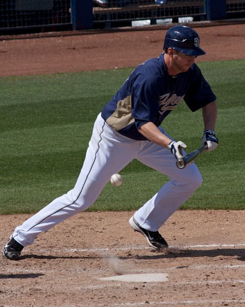 Padres player fouling a bunt attempt against Dodgers in Spring training, March 26, 2011, Peoria, Arizona.