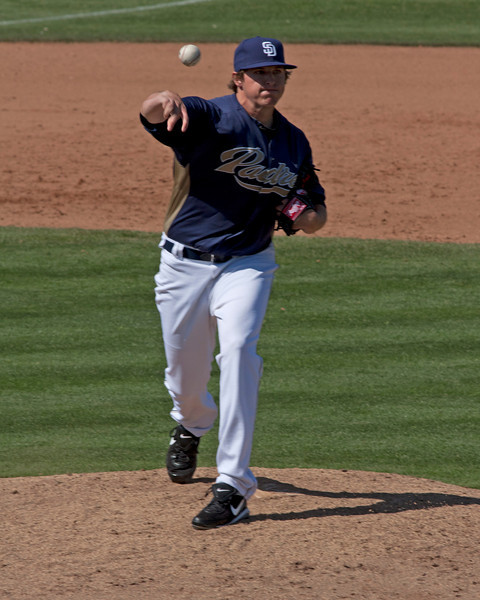 Padres pitcher throwing to 1st base against the Dodgers at Spring Training in Peoria, Arizona. March 26, 2011.